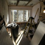 Gutted room, under renovation, notice large windows which are now focal point